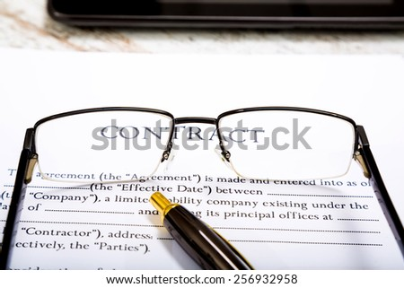 Reading a Contract before signing  - stock photo