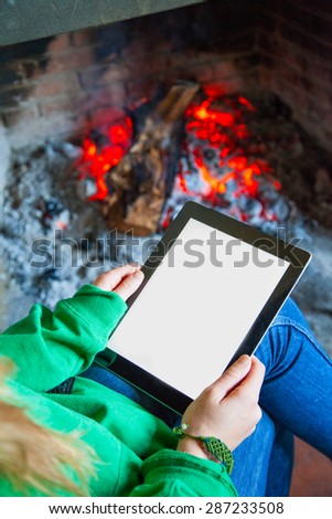 Reading book on digital tablet - stock photo