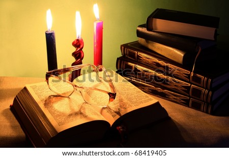 reading books and burning candles