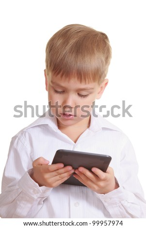 Reading boy with electronic book. Isolated on white - stock photo