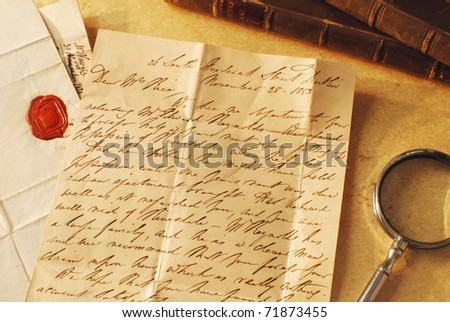Reading correspondence from the 1800's - stock photo