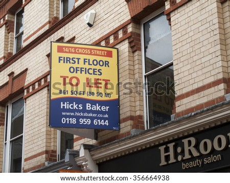 Reading, Cross Street, Berkshire, England - December 22, 2015: First floor offices to let sign over retail premises