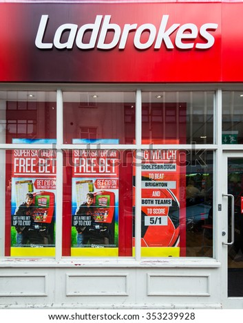 READING,ENGLAND-DECEMBER 19,2015:A Ladbrokes betting office. It has 2,800 betting shops in the UK, Ireland, Belgium and Spain, annual Group revenues of over GBP1 billion and employs 14,000 people. - stock photo