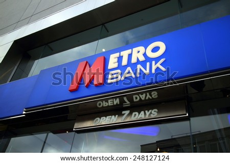 Reading, England - January 29, 2015: The sign above the entrance to the Metro Bank in Reading, England. Started in 2010, Metro Bank is Britain's first new High Street bank in over 100 years - stock photo