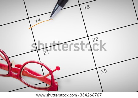 Reading glasses against january calendar