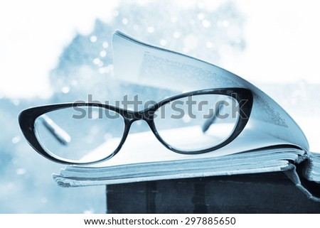 Reading glasses and books over the window