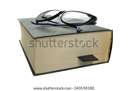 reading glasses on an closed book on white background, shallow DOF - stock photo