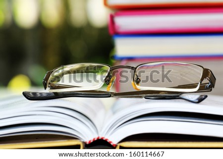 Reading glasses on books