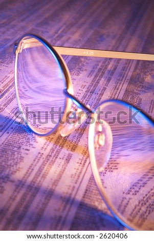 Reading glasses on stock report