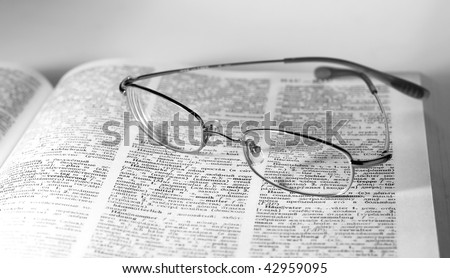 reading glasses on the book