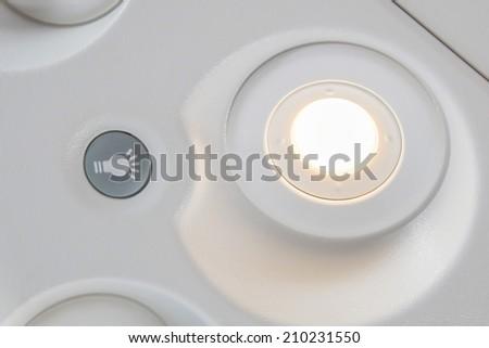 reading light on plane - stock photo