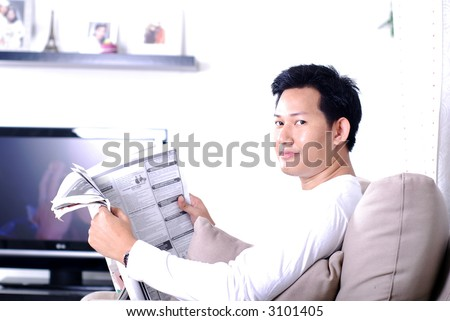Reading news paper looking for jobs