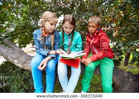 Reading outside - stock photo