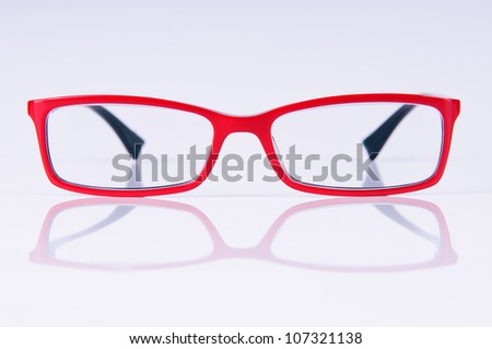 reading red glasses. close-up. on a light gray background - stock photo