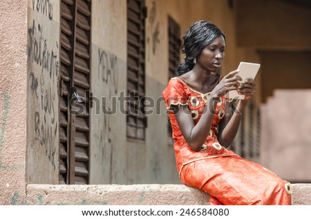 Reading Symbol: African Black Ethnicity Woman Reading On Tablet Computer  - stock photo