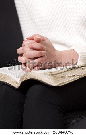 Reading the bible and pray - stock photo