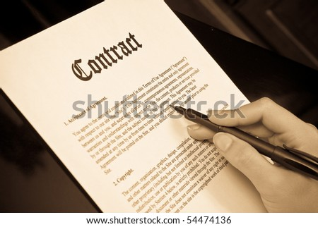 Reading the Contract Concept - stock photo