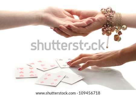reading the lines hand in a woman's hands isolated on white - stock photo