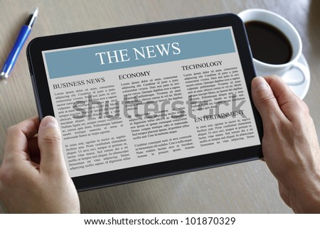 Reading the news on a digital tablet