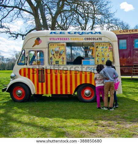 READING,UK-APRIL 11,2015-Ice Cream vintage van waiting for customer in fun fair. - stock photo