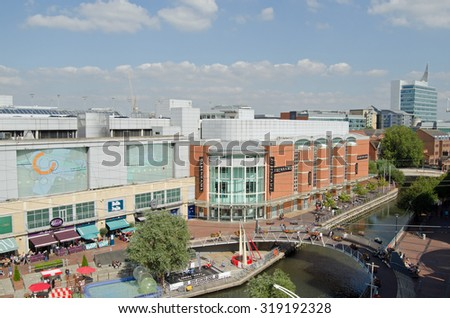 READING, UK - SEPTEMBER 10, 2015:  Aerial view of the River Kennet in the centre off Reading, Berkshire as pedestrians and shoppers enjoy the early afternoon sunshine at the Oracle Shopping Centre. - stock photo