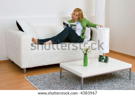 Reading woman at home - stock photo