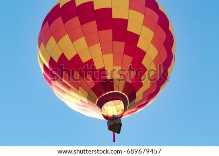 Readington, New Jersey/USA - 7/30/2017: [Festival of Ballooning; Individual hot air balloon, individuals on the balloon enjoying the scenic view]