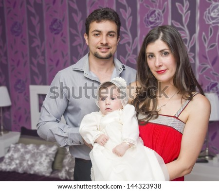 Ready for ceremony. Portrait of family with baby ready for baptism - stock photo