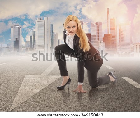 Ready for challenge - portrait of beautiful young woman sitting in front of the city