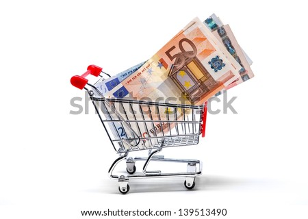 Ready for shopping - grocery cart with euro bills isolated on white  - stock photo