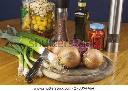 ready for slicing onions, homemade food preparation, ingredients and seasonings for cooks - stock photo