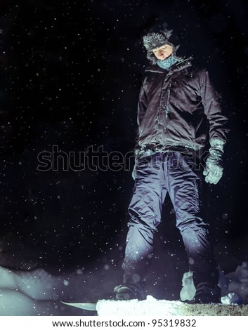 Ready for snowboard jump - stock photo