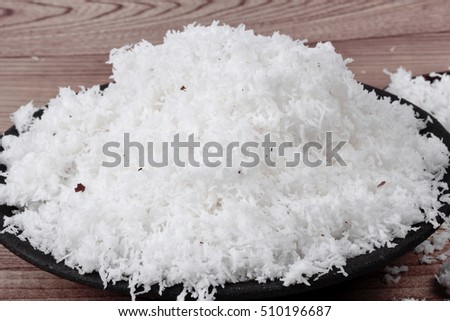 Ready grated coconut for cooking .