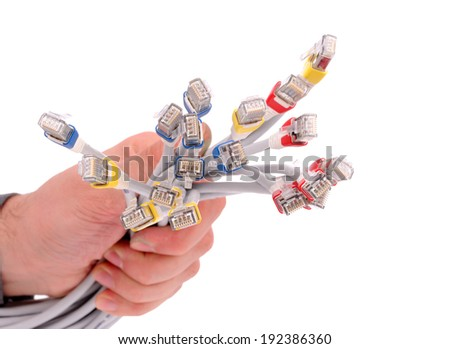 Ready-made LAN cable on IT professional hand - stock photo