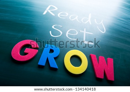 Ready, set, grow! Colorful conceptual words on blackboard. - stock photo