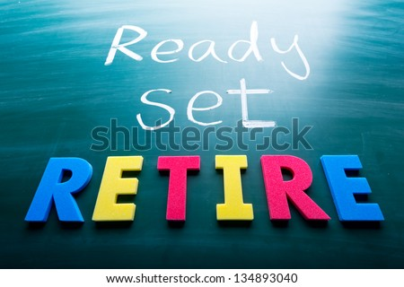 Ready, set, retire! Colorful conceptual words on blackboard. - stock photo