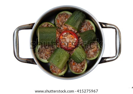 ready-stuffed zucchini with tomato in a pot home