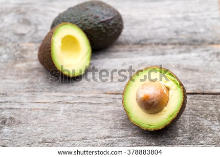 Ready to eat avocado on a wooden surface