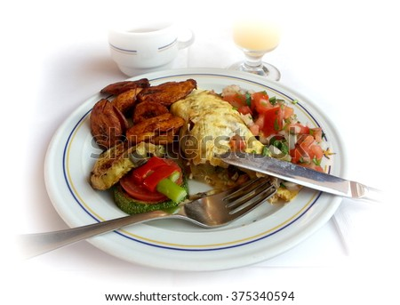 Ready to eat breakfast omelette with fried bananas and assorted salads and side dishes at an all-inclusive buffet - stock photo