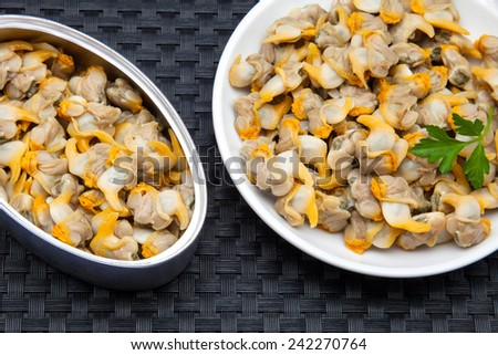 ready-to-eat cockles canned with parsley - stock photo