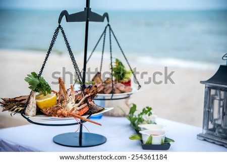 ready to eat seafood on the beach - stock photo