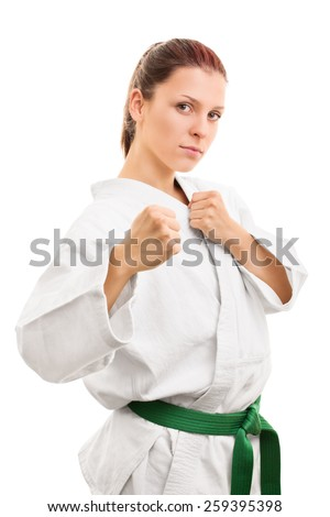 Ready to engage. Young in kimono isolated on white background - stock photo