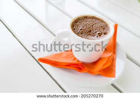 Ready to serve cup of traditional greek coffee - stock photo