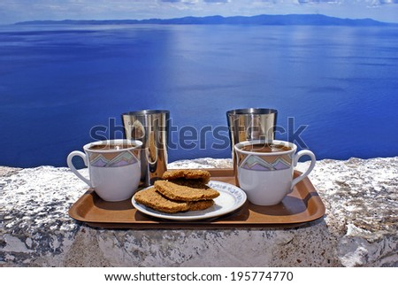 Ready to serve cups of coffee against blue sky - stock photo