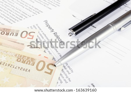 Ready to sign and pay for a property contract  - stock photo