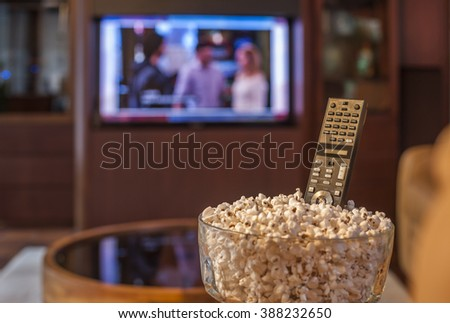 Ready to watch TV with bowl of pop corn - stock photo
