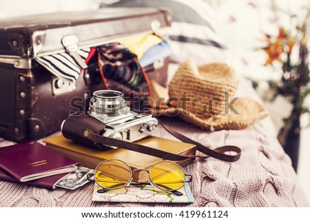 Ready vacation suitcase on bed - stock photo