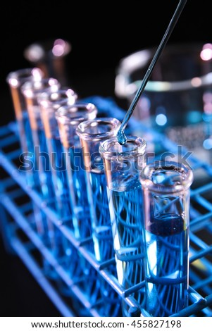 Reagent dropped into test tube containing blue chemicals