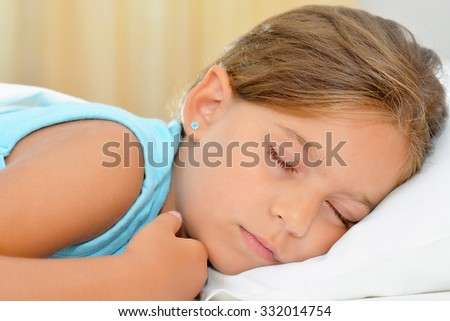 Real adorable girl sleeping, sweet dreams