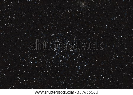 Real astronomical picture taken using telescope, it is an open star cluster known as Messier 35, in Gemini constellation - stock photo